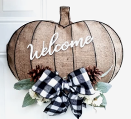 welcome wreath in the shape of a pumpkin