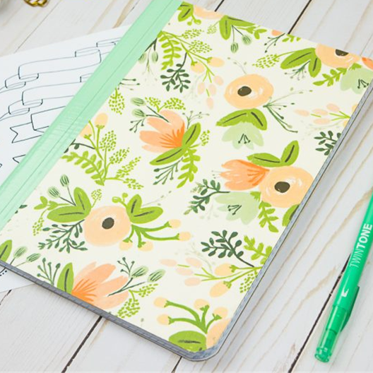 notebook with decorative floral cover