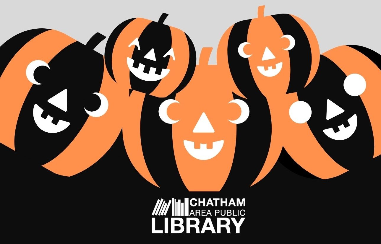 Three large and two small smiling orange and black clip art jack-o-lanterns